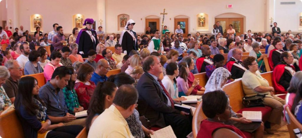 Knights of Columbus processing into Mass with a packed Church